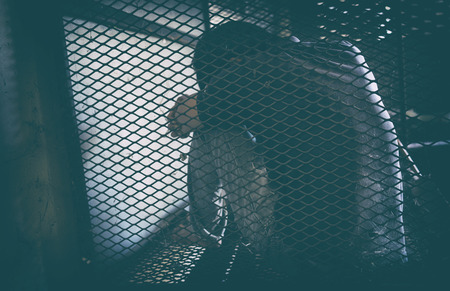 hopeless man in the cage,  human trafficking  Stock Photo