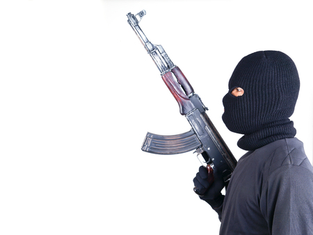 male killer: terrorist with ak47 machine gun isolated on white background