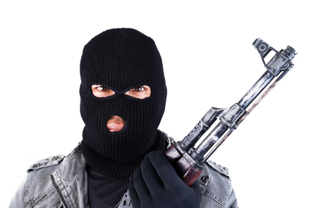 terrorist with ak47 machine gun isolated on white background