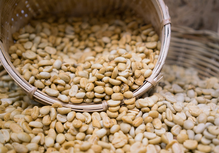 unroasted: unroasted coffee beans in basket