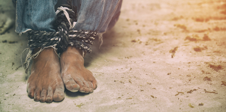 human trafficking, feeds tied together with rope Stock Photo
