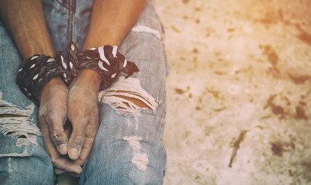 maltreatment: human trafficking, hands tied together with rope