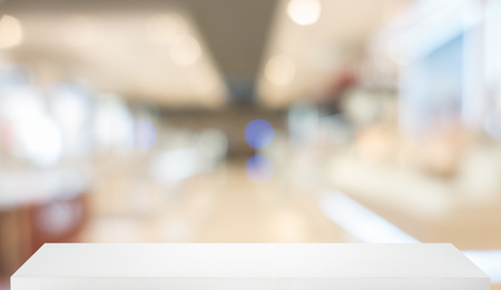 Blurred, defocused convenience store with wooden shelf Stock Photo
