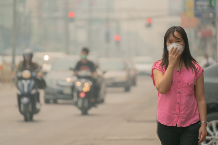 Young woman wearing protective mask in the city street, chiang mai thailand Standard-Bild - 120218034