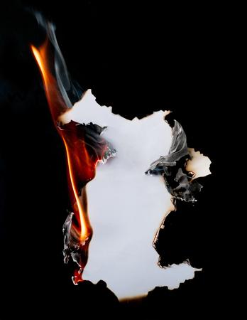 burning piece of  paper on black background Stock Photo - 122269319