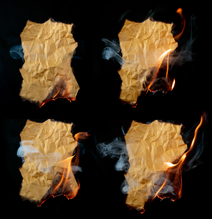 burning piece of crumpled paper on black background Фото со стока