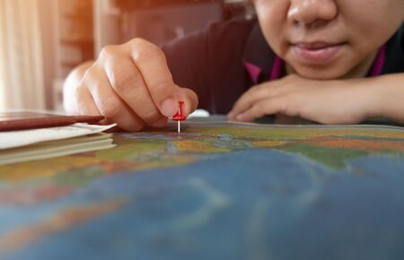 asian woman pinned on the map location Stock Photo