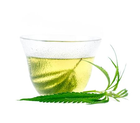 marijuana herbal tea served in glass teacup Stock Photo