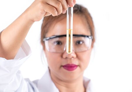 asian woman scientific research looking  solution in tube