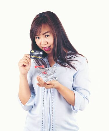 Women holding credit cards and shopping cart, shopping concept