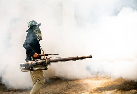 man use fumigation mosquitoes machine for kill mosquito carrier of Zika virus and dengue fever around the house