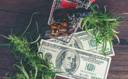 cannabis with cannabidiol (cbd) extract on hundred dollar banknote Фото со стока
