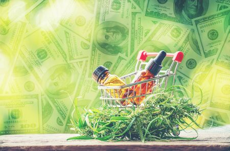 cannabidiol (cbd) extract in a shopping cart and dollar banknote background