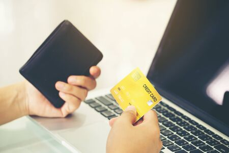 Women use credit card to shopping online at her home