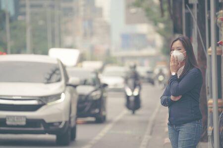 woman wearing protective mask in the city street, Bangkok thailand Фото со стока