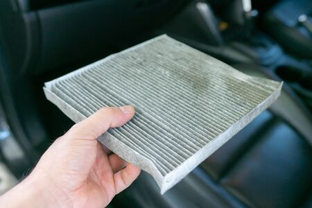 hand hold dirty car air conditioning filter