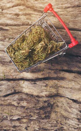 dried cannabis medical marijuana in mini trolley Stock Photo