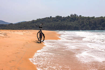 bicycle on a sand shore