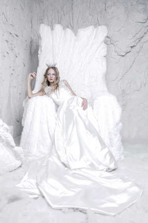 girl sitting on ice throne