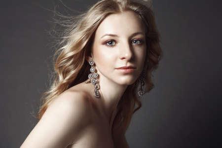 portait: Beauty portrait of female posing in studio on grey background