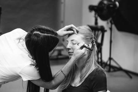 Makeup artist at work black and white photo