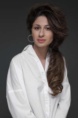 studio portrait of a girl on grey background
