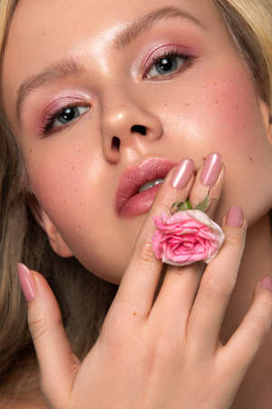 Beauty portrait of female face with flower Stock Photo