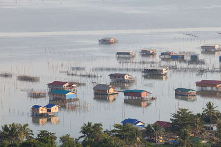 fishing village with floating houses Stock Photo