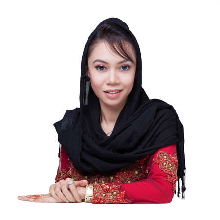 Beautiful muslim lady wear red with hijab, smile and look at camera Stock Photo