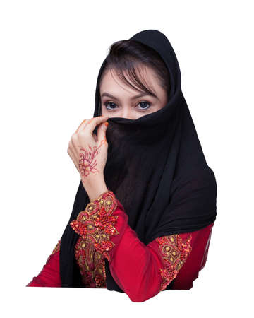 Beautiful muslim lady wear red with hijab, henna painted on hand photo