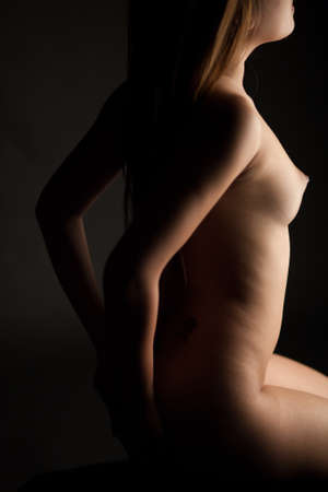 nice breast: naked body and nice breast on black background Stock Photo