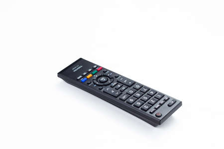 tv remote control keypad black on white isolated photo