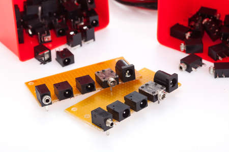 Printed circuit board kits mounting with too many kind of connector. Place on white table. Stock Photo