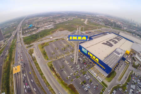 ikea: BANGNA, THAILAND-JANUARY 18, 2015: Arial view in sunset. The Ikea store of Thailand. IKEA is the worlds largest furniture retailer and sells ready to assemble furniture. Founded in Sweden in 1943