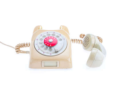 telefono antico: Antique Telephone Placed on a isolated white background. The headset is removed from the set. Placed next to the side.