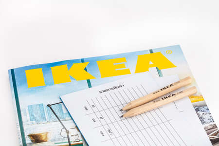 SONGKHLA THAILAND - JANUARY 27, 2015: Pencil and brochures and catalogs of IKEA . Was put together on a white background . IKEA Founded in Sweden in 1943, Ikea is the worlds largest furniture retailer.