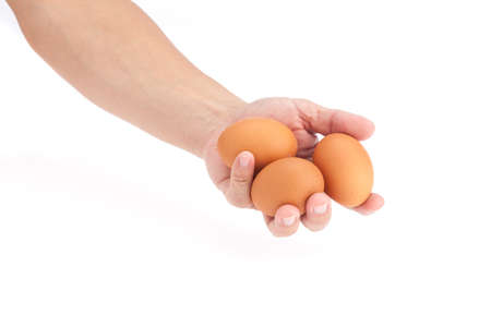 Hand hold 3 eggs on white background photo