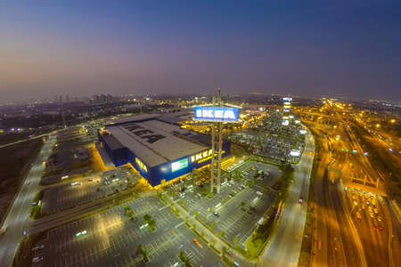 arial view: BANGNA, THAILAND-JANUARY 18, 2015: Arial view in sunset. The Ikea store of Thailand. IKEA is the worlds largest furniture retailer and sells ready to assemble furniture. Founded in Sweden in 1943