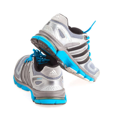 adidas: JANUARY 27, 2015 - THAILAND : running shoes of the brand Adidas on isolated white background Editorial