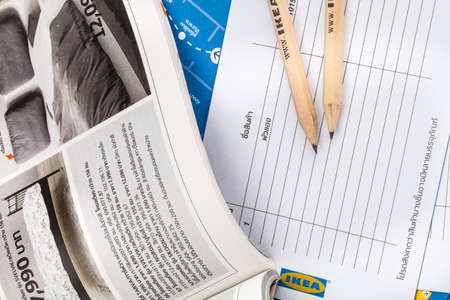 ikea: SONGKHLA THAILAND - JANUARY 27, 2015: Pencil and brochures and catalogs of IKEA . Was put together on a white background . IKEA Founded in Sweden in 1943, Ikea is the worlds largest furniture retailer.