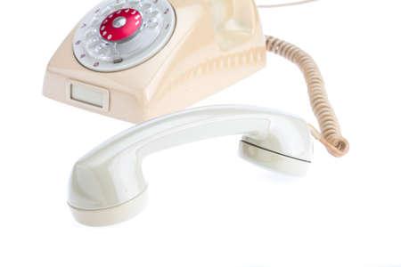telefono antico: handset of antique telephone placed on isolate white background