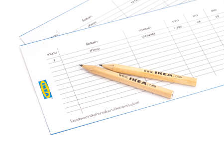 SONGKHLA THAILAND - JANUARY 27, 2015: IKEA pencil is placed on a list of purchases . IKEA Founded in Sweden in 1943, Ikea is the world's largest furniture retailer.