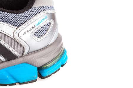adidas: SONGKHLA , THAILAND - JANUARY 27, 2015 : ADIDAS response cushion22 sport shoe, used. Isolated on white.