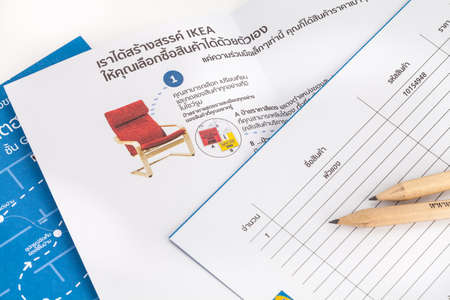 ikea: SONGKHLA THAILAND - JANUARY 27, 2015: IKEA pencil is placed on a list of purchases . IKEA Founded in Sweden in 1943, Ikea is the worlds largest furniture retailer.