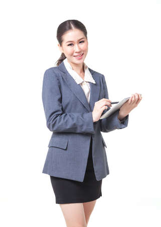 web feed: asian business women working with digital tablet. shot on white background
