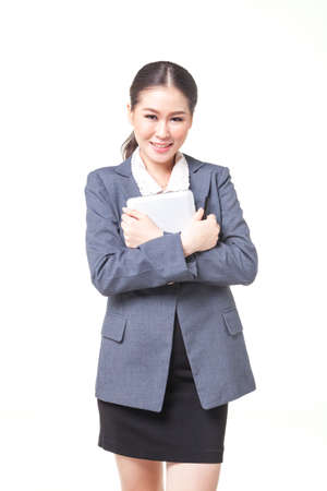 web feed: asian business women working hold digital tablet. shot on white background