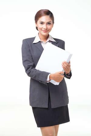 asian business women: asian business women working hold file. shot on white background