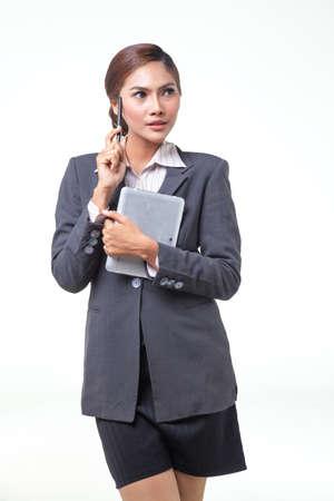 asian business women: asian business women working hold digital tablet. shot on white background
