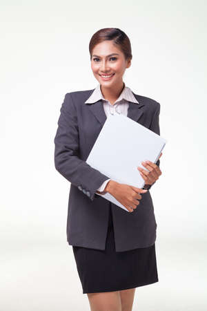 web feed: asian business women working hold file. shot on white background