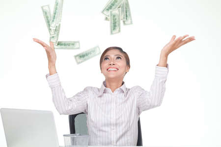 carreer: Asian business woman Throw bank notes in to the air with smiling face. isolated white Stock Photo